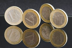 Four euro coins Stock Images
