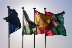 Four european backlit flags. Four backlited flags (Spain and portugal among them) with wind Royalty Free Stock Photos
