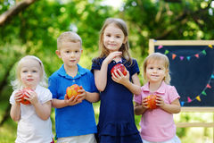Four excited little kids by a chalkboard Stock Photography