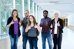 Four excited students with professor. Four excited University students with professor Stock Photo