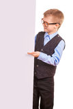 Four-eyes Boy holding a banner isolated on white Royalty Free Stock Photos