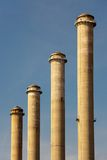 Four factory chimneys Royalty Free Stock Photos