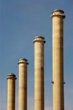 Four factory chimneys Royalty Free Stock Photos