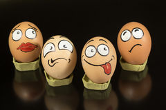 Four fanny egg faces waiting to be cooked Royalty Free Stock Photos