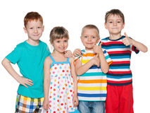 Four fashion cheerful children Stock Photo