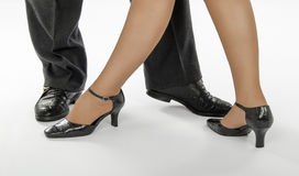 Four feet showing tango pose Stock Image