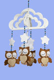 Four Felt Owls on Beaded Baby Cot Mobile Stock Photo