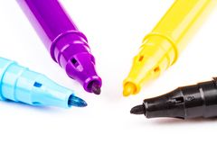 Four felt-tip pens with CMYK primary colors Royalty Free Stock Photo