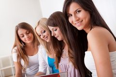 Four female students doing homework Royalty Free Stock Photo