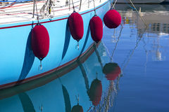 Four fenders at the sailing boat.  Stock Photos