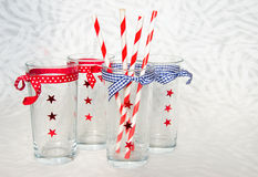 Four festive glasses with straws Royalty Free Stock Photo