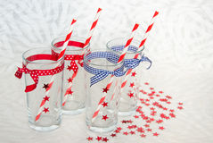Four festive glasses with straws Royalty Free Stock Images