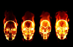 Four fiery flaming skulls Stock Images
