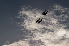 Four fighters  in  the  sky. Aerobatics. MAKS-2015. The patterns in the sky Stock Photography