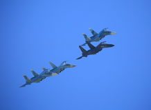 Four fighters in sky royalty free stock photos