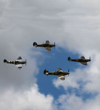 Four fighters. Two Supermarine Spitfires flying in formation with two Hawker Hurricanes Stock Image