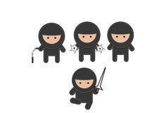 Four fighting ninja's in black outfits Royalty Free Stock Image