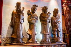 Four figures. In Chinese restaurant interior Stock Image