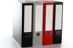 Four file folders. In a row on a desk Stock Photo