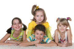 Four fine lying kids Royalty Free Stock Photography