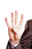 Four finger sign. A suited man holding four finger sign on white background Stock Image