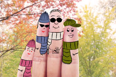 Four fingers with autumn clothes Royalty Free Stock Images