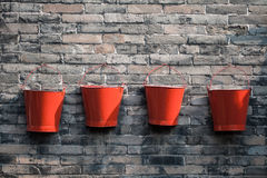 Four fire buckets Stock Photos