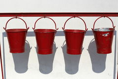 Four fire buckets hanging Stock Images
