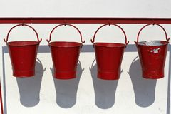 Four fire buckets hanging Stock Image