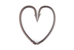 Four fishhook drawn up in heart shaped Royalty Free Stock Photo