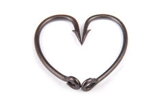 Four fishhook drawn up in heart shaped Stock Photography