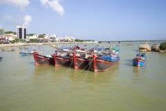 Four fishing schooners standing on the dock on the river Kai. Nha Trang, Vietnam Stock Photo