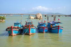 Four fishing schooners are up on the river Kai before going into the sea on a sunny day. Nha Trang, Vietnam Stock Photos