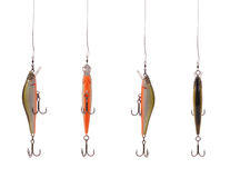 Four fishing wobbler. Four fishing floating wobbler hanging top of the screen isolated on white Stock Photo