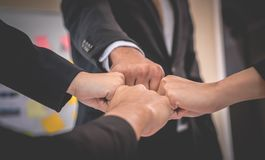 Four Fist bump in meeting for team concept. Four Fist bump in business meeting for team concept royalty free stock photos
