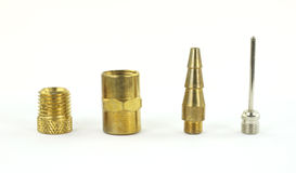 Four fittings for an air compressor Royalty Free Stock Photo