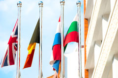 Four flags on flagpoles. Countries Royalty Free Stock Photos