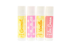 Four flavoured lip balms. Stock Images