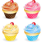 Four Flavours of Cupcakes. A selection of four fairy cakes. Chocolate, vanilla, strawberry, and blueberry cupcakes Royalty Free Stock Photo