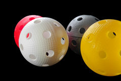 Four floorball balls isolated Stock Photography