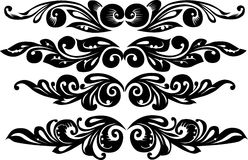 Four floral curled elements Royalty Free Stock Image