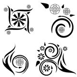 Four floral tattoo designs. Set of four tattoo designs with flame and plant elements Stock Photos