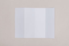Four fold white template paper on grey background. Four fold white template paper on grey background Stock Image