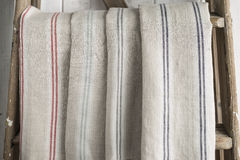 Four Folded Striped Cotton Linen Hanging on a Stepladder Stock Photo