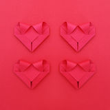 Four folding red paper hearts on red for valentine pattern and b Royalty Free Stock Image