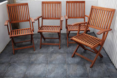 Four folding wooden chairs Royalty Free Stock Photography