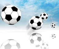 Four football balls on clear spacious field Royalty Free Stock Photos