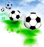 Four football balls on field with blue sky. Four style football balls jumping on the field with blue sky background Stock Photography