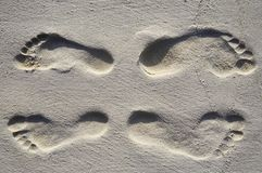 Four footsteps on a beach stock photography