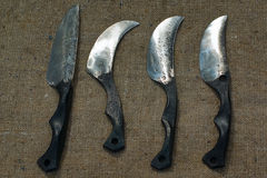 Four forged knife on sacking. Stock Photo